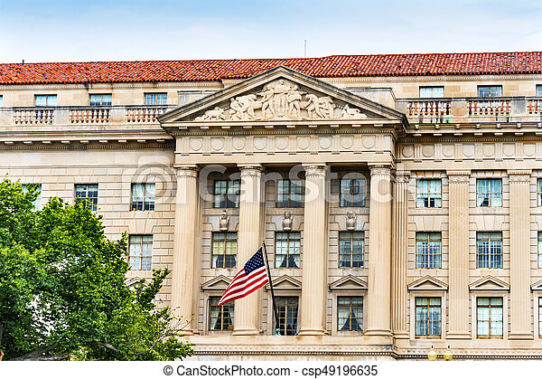 Commerce Department Secretary\'s Entrance 15th Street Flag Washington DC. Across from the White House, Commerce has multiple departments, including the International Trade Administration, Export Administration, Import Administration and other departments.