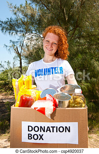 volunteer carrying food donation box - csp4920037