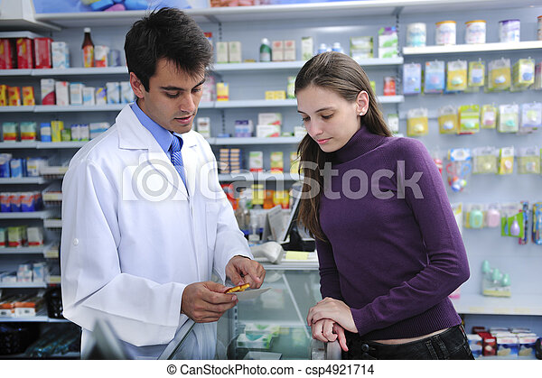 Pharmacist advising client at pharmacy - csp4921714