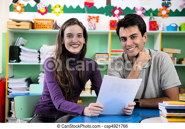 Teacher and parent in classroom - csp4921766