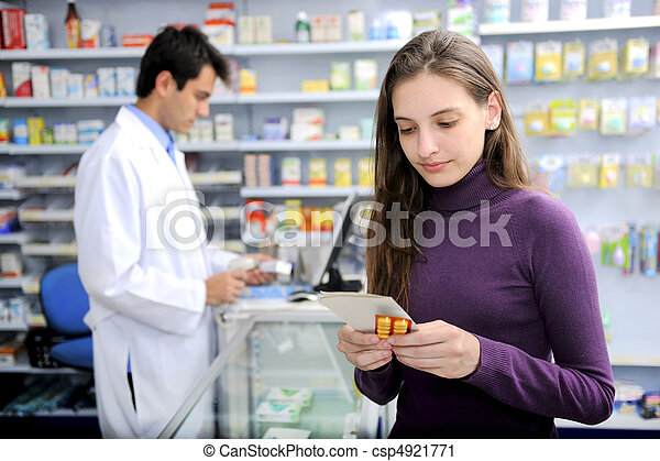 Consumer with medicine at pharmacy - csp4921771