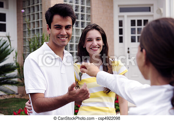 Real estate agent handing over house key - csp4922098