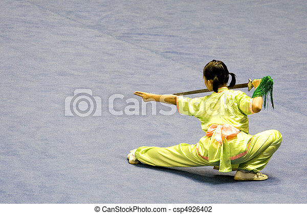 Chinese martial arts exponent in a Wushu competition.