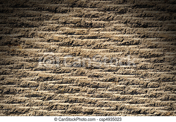 Grooved asphalt or rock surface texture lit from above - csp4935023