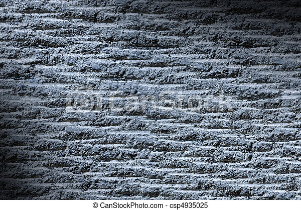 Grooved asphalt or rock surface texture lit diagonally with blue light - csp4935025