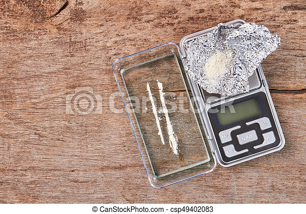 Digital equipment for drugs weight. Glass, powder, foil, digital scales.