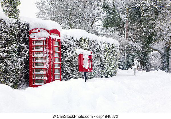 Red telephone and post box in the snow - csp4948872