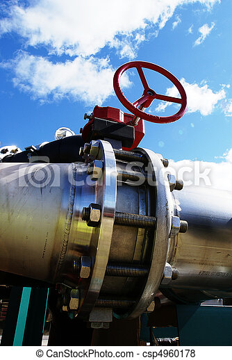 Industrial zone, Steel pipelines and valves against blue sky - csp4960178