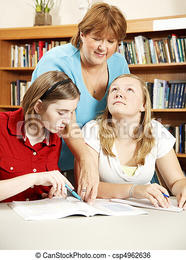 Librarian Assisting Students - csp4962636