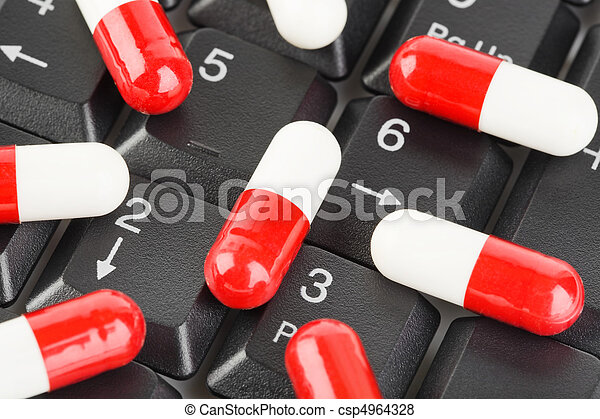 Pills on computer keyboard - csp4964328