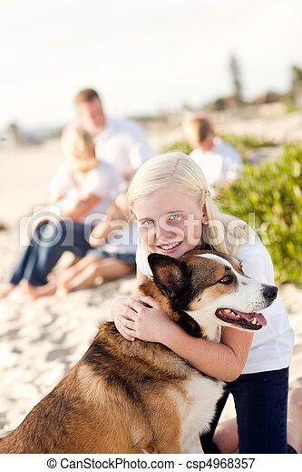 Cure Girl Playing with Her Dog Outside - csp4968357