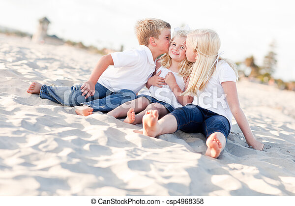 Adorable Sibling Children Kissing the Youngest - csp4968358