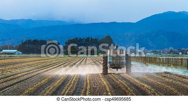 Early Morning Crop Spraying - csp49695685