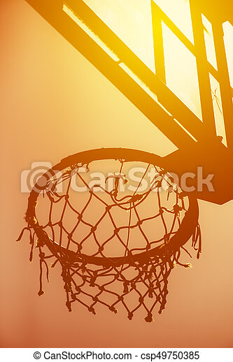 Basketball hoop on amateur outdoor basketball court for streetball, against strong summer sunlight