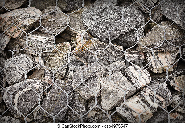 Road embankment of gravel reinforced with steel mesh - csp4975547