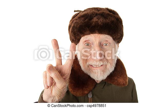 Russian Man in Fur Cap Making Peace Sign - csp4978851