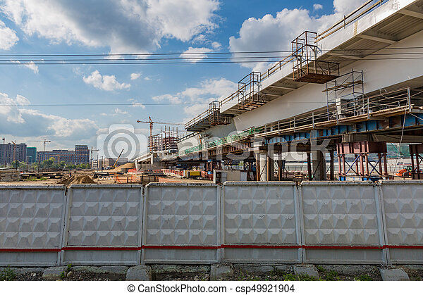 Large-scale construction of a massive transport bridge on a summer day