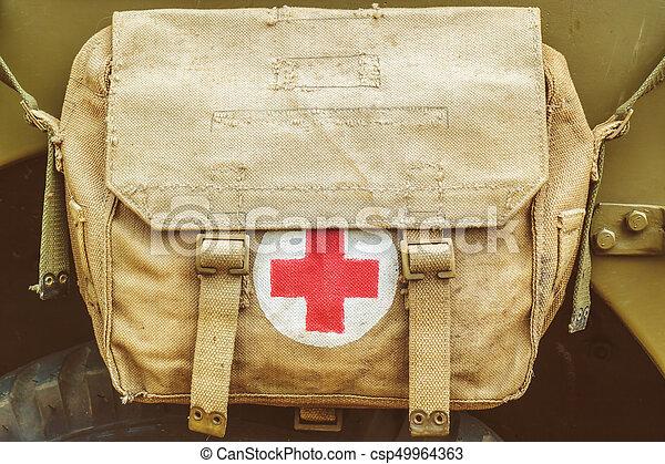 Red cross medical aid symbol on a vintage jute army bag