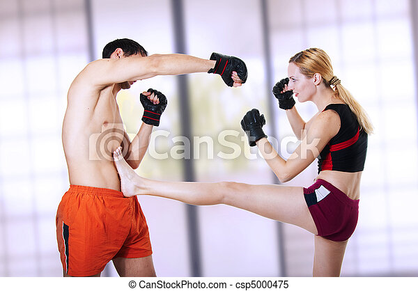 Woman fighter - front kick. self-defense - csp5000475