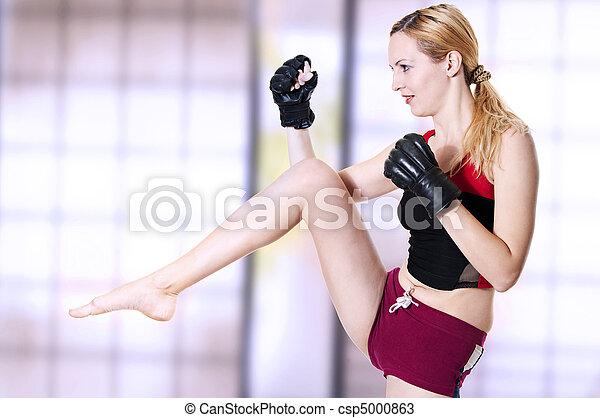 Woman fighter knee kick. - csp5000863