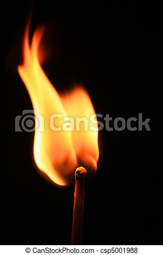 Macro of burning match on black background - csp5001988