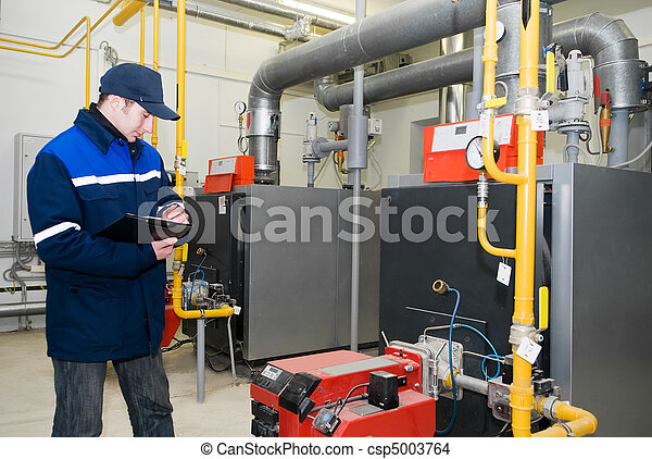 heating engineer in boiler room - csp5003764
