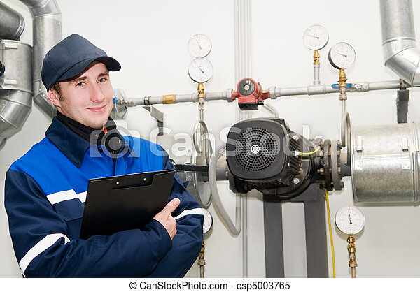 heating engineer in boiler room - csp5003765