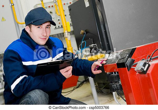 heating engineer in boiler room - csp5003766