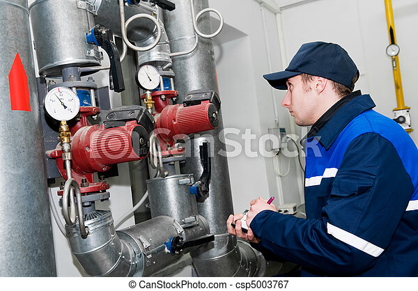 heating engineer in boiler room - csp5003767