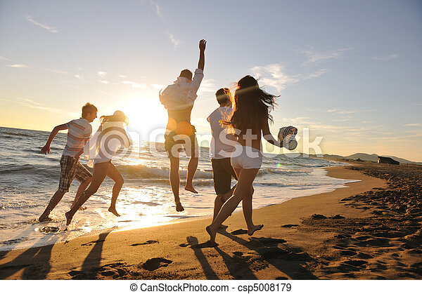people group running on the beach - csp5008179