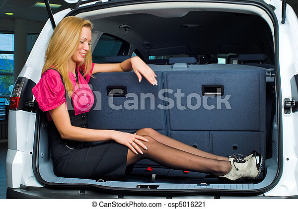 Woman in luggage compartment - csp5016221