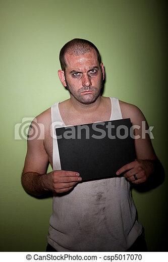 Angry man in mugshot - csp5017070