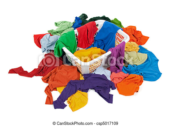 Bright messy clothes in a laundry basket - csp5017109