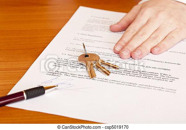 Handing over of keys after contract signing of house sale - csp5019170