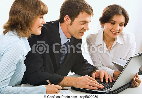Business team discuss business ideas in front of the computer