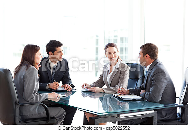 Businessmen and businesswomen talking during a meeting - csp5022552