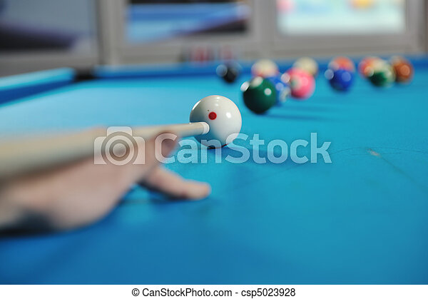 young man play pro billiard game  - csp5023928
