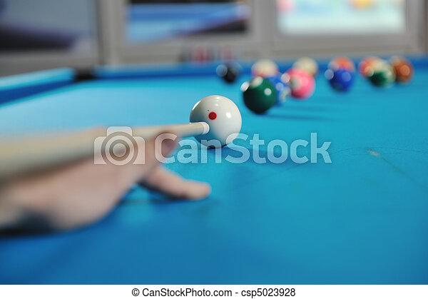 young man play pro billiard game  - csp5023928