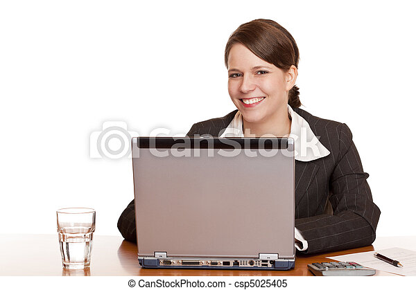 Young business woman sitting happy in office and works on computer - csp5025405