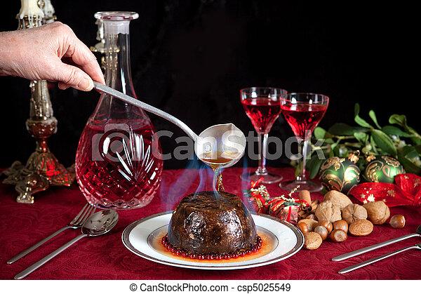 Christmas pudding flambe - csp5025549