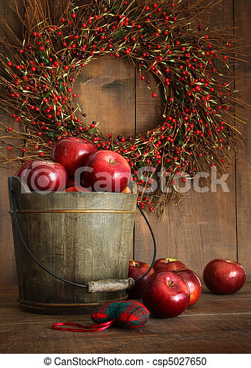 Wood bucket of apples for the holidays - csp5027650
