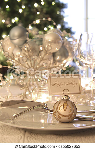 Elegant holiday dinner table with focus on place card - csp5027653