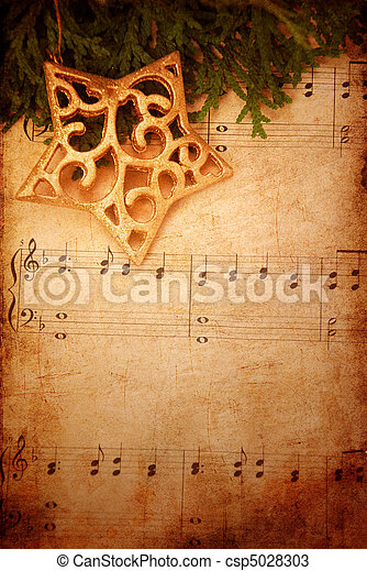 Christmas background with old sheet music    - csp5028303