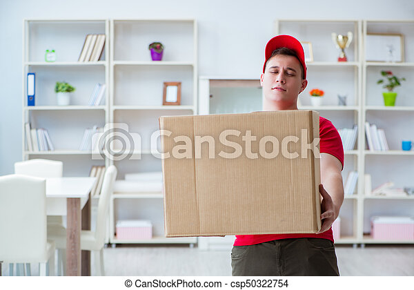 Post man delivering a parcel package - csp50322754