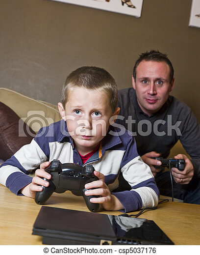 Father and son Playing Video Games - csp5037176