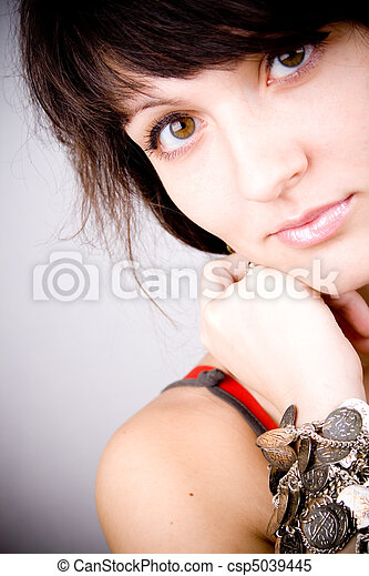 brunette lady with bracelets - csp5039445