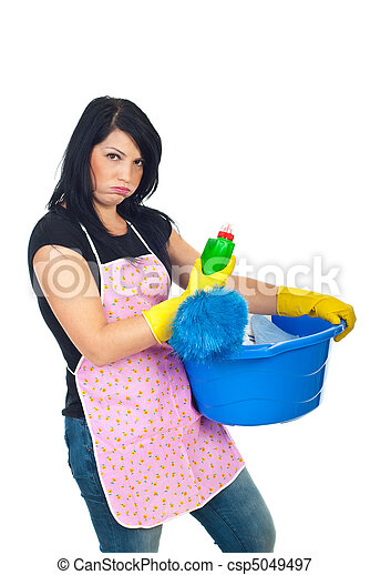 Miffed woman holding cleaning products - csp5049497