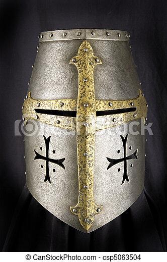 Iron helmet of the medieval knight. Very heavy headdress - csp5063504