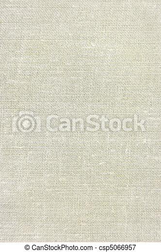 Natural vintage linen burlap texture background in tan, beige, yellowish, grey - csp5066957