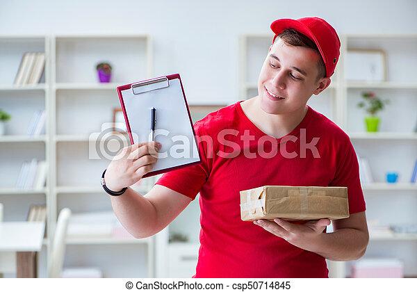 Post man delivering a parcel package - csp50714845